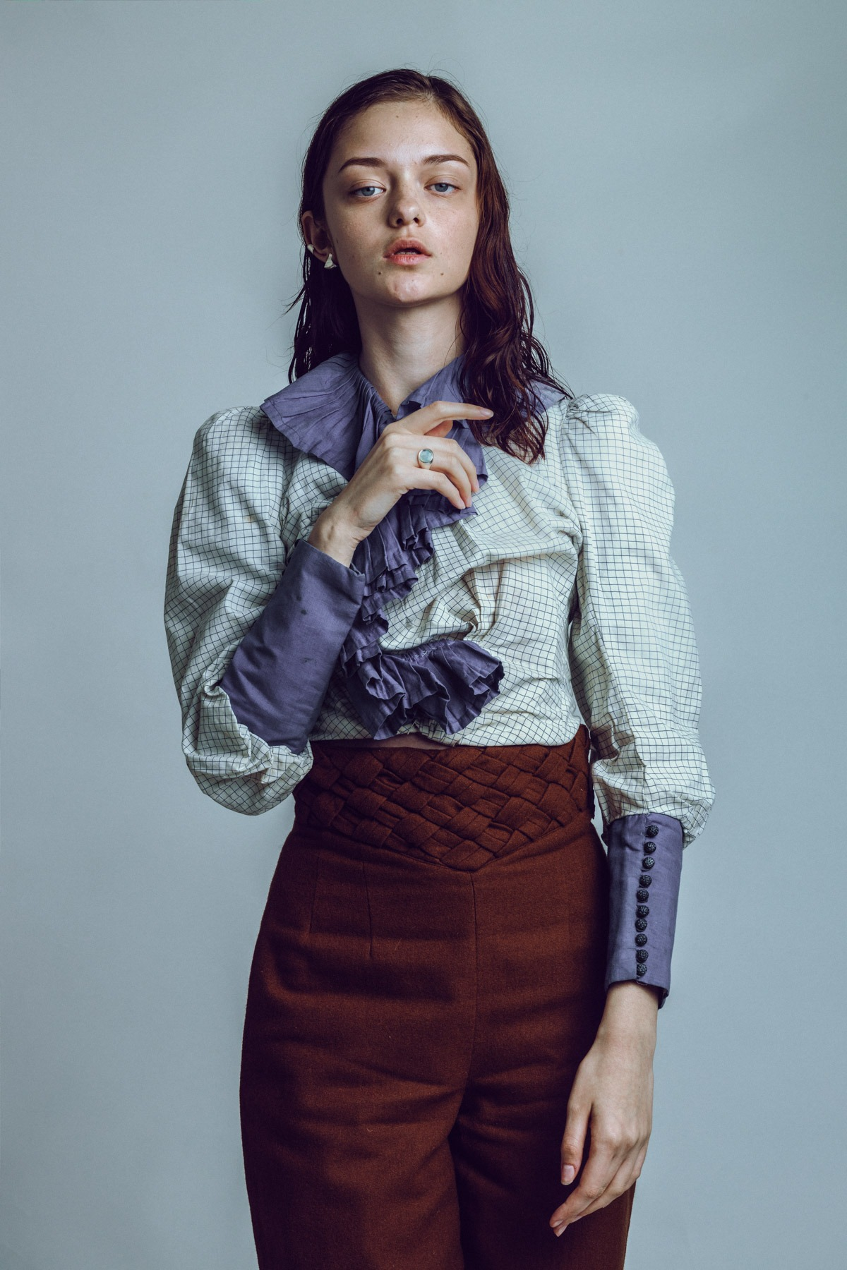 anmoda models tokyo alyona wearing a vintage checked shirt and dlaw jewelry, holding flowers in a studio in tokyo