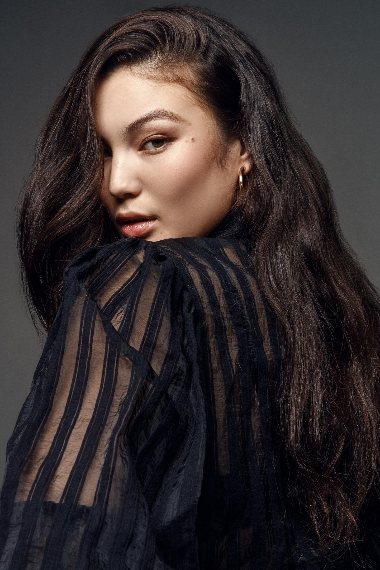portrait of model sarah hemi system agency wearing sequin top in a studio in Tokyo