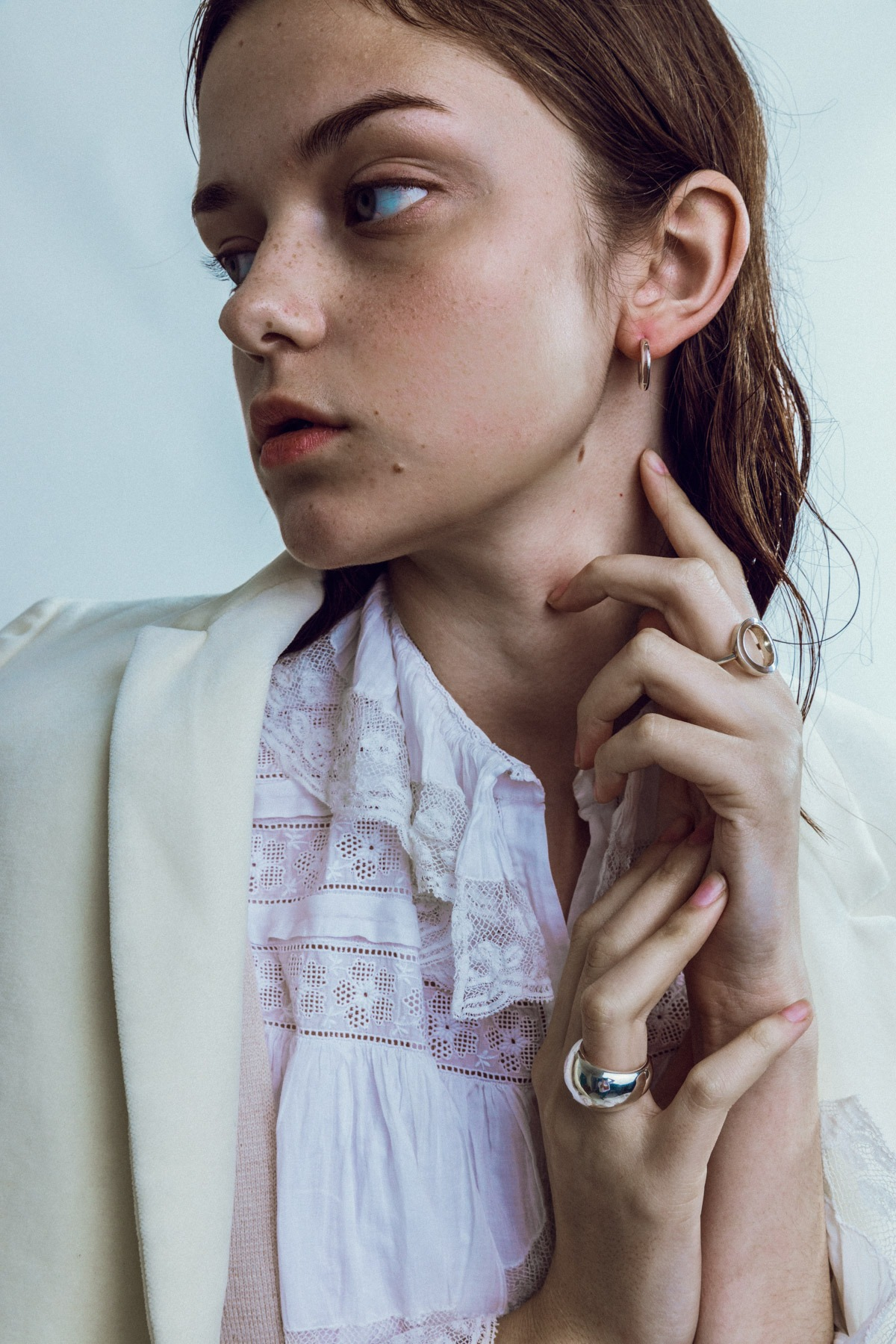 anmoda models tokyo model wearing vintage eyelet blouse and white blazer with dlaw jewelry in tokyo studio by ivana micic